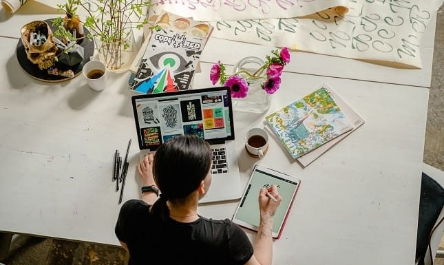 Woman making designs for online business startup
